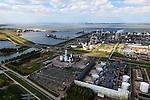 Nederland, Zeeland, Terneuzen, 09-05-2013; Zeeuws-Vlaanderen, Terneuzen. Zicht op de Westerschelde met aan de andere oever Zuid-Beveland.  <br /> Site van de chemische fabriek van Dow (Dow Chemical Company) aan de Westerschelde. De kraakinstallaties maken o.a. benzeen, ethyleen en propyleen (basischemicalien voor halffabrikaten voor verschillende kunststoffen).<br /> Zeeuws-Vlaanderen,  the south-west part of the province of Zeeland site of the chemical plant of Dow Chemical Company. This plant produces benzene, ethylene and propylene, the basis for various plastics. View on the Westerschelde.<br /> luchtfoto (toeslag op standard tarieven);<br /> aerial photo (additional fee required);<br /> copyright foto/photo Siebe Swart.