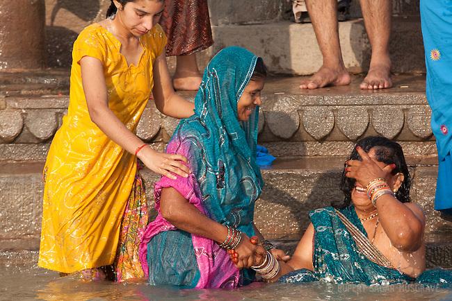 Women bathing in the holy river Ganges at Varanasi, Uttar Pradesh
