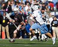 Dave Spaulding (30) of Johns Hopkins movies in on Mike Chanenchuk (13) of Princeton during the Face-Off Classic in at M&T Stadium in Baltimore, MD