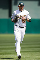 6 April 2008: A's #15 Ryan Sweeney runs back to the dugout during the Cleveland Indians 2-1 victory over the Oakland Athletics at the McAfee Coliseum in Oakland, CA.