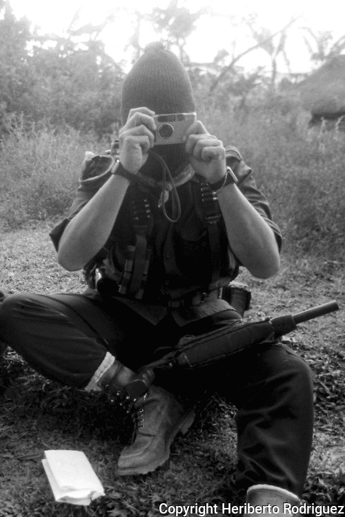 Subcomandante Marcos takes a photograph prior to an interview to journalists  in the Zapatista stronghold of Prado Pacayal, in southern state of Chiapas, March 22, 1994.  Photo by Heriberto Rodriguez