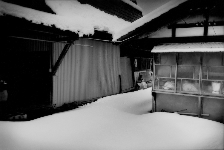Fukushima's Nuclear Winter: No footsteps into or out of the barn at this evacuated family farm in Fukushima's extended nuclear evacuation zone, Iitate-mura, Fukushima Prefecture, Japan.  Iitate-mura was contaminated by wind-driven radioactive fall-out from the Fukushima Dai Ichi nuclear power plant.  Iitate-mura sits in an area that annual ambient radiation rates are estimated to be over 20 millisieverts in most areas and others are at over 50 millisieverts annually, the latter of which may indicate that decontamination may take decades.