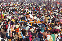 "India. Uttar Pradesh state. Allahabad. Maha Kumbh Mela. Seers and gurus seated on a four wheel drive vehicle on the day of Mauni Amavasya Snan (Royal bath for Dark moon). The ritual ""Royal Bath"" is timed to match an auspicious planetary alignment, when believers say spiritual energy flows to earth. The Kumbh Mela, believed to be the largest religious gathering is held every 12 years on the banks of the 'Sangam'- the confluence of the holy rivers Ganga, Yamuna and the mythical Saraswati. In 2013, it is estimated that nearly 80 million devotees took a bath in the water of the holy river Ganges. The belief is that bathing and taking a holy dip will wash and free one from all the past sins, get salvation and paves the way for Moksha (meaning liberation from the cycle of Life, Death and Rebirth). Bathing in the holy waters of Ganga is believed to be most auspicious at the time of Kumbh Mela, because the water is charged with positive healing effects and enhanced with electromagnetic radiations of the Sun, Moon and Jupiter. The Maha (great) Kumbh Mela, which comes after 12 Purna Kumbh Mela, or 144 years, is always held at Allahabad. Uttar Pradesh (abbreviated U.P.) is a state located in northern India. 10.02.13 © 2013 Didier Ruef"