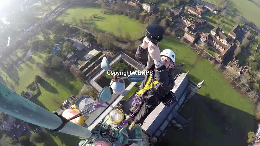 BNPS.co.uk (01202 558833)<br /> Pic: GaryPrice/BNPS.<br /> <br /> Dont look down, Gary gets to work on the faulty wind guage.<br /> <br /> Ultimate selfie - Birds eye view from the worlds tallest medieval building.<br /> <br /> This is Salisbury Cathedral Clerk of Works Gary Price's stomach-flipping view from the dizzying top of Britains tallest spire, something very few people have seen for over 750 years.<br /> <br /> Kitted out in ropes, a harness and a hard hat and accompanied by rope access specialists from Vitruvius Conservation, Gary made the hair-raising climb up the 404ft spire to replace the cathedral's faulty wind meter.