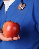 Doctor and apple stock photo