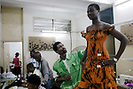 ACCRA, GHANA - JUNE 13: Mawuli Kofi Okudzeto, a fashion designer, fits a new dress on a model in the back of his factory on June 13, 2008 in central Accra, Ghana. His clothing line MKOGH is famous and he hopes to work with Herman Chinery-Hesse, a local software entrepreneur, who is pioneering to bringing e-commerce to remote corners of the continent. (Photo by Per-Anders Pettersson)..