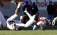 Nov 27, 2010; Charlottesville, VA, USA; Virginia Cavaliers wide receiver Dontrelle Inman (81) is tackled by Virginia Tech Hokies cornerback Jayron Hosley (20) during the game at Lane Stadium. Virginia Tech won 37-7. Mandatory Credit: Andrew Shurtleff