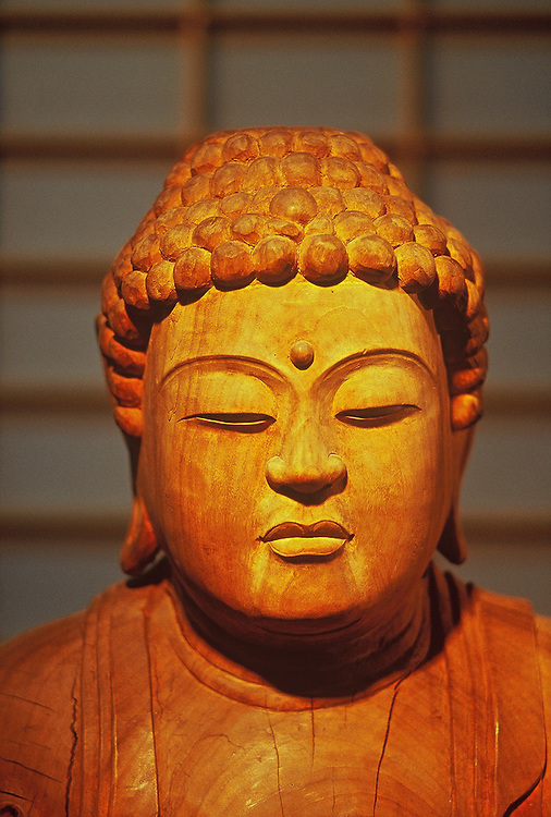 Serene, old, carved, wooden buddha, Vancouver, BC.