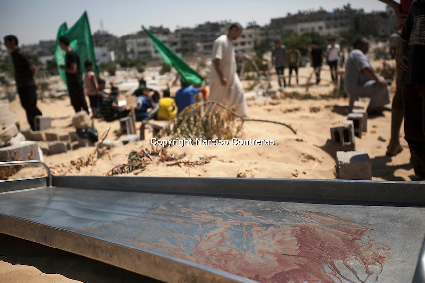 "August 20, 2014 - Gaza City, Gaza strip, Palestinian Territory: The stretcher where Sofian Moheasin was carried out to the cementery is seen covered by blood in the Beit Lahia neighborhood of Gaza City after night airstikes continued as ""Protective Edge"" Israeli military operation resumed when the truce was broken in the Gaza strip. (Narciso Contreras/Polaris)"