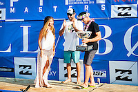 PIPELINE, Oahu/Hawaii (Saturday, December 14, 2013) with Lyndie Irons (USA) Mick Fanning (AUS) is congratulated by good friend and 2012 World Champion Joel Parkinson (AUS) after handing over the World Title trophy. - Kelly Slater (USA), 41, has won his 7th Billabong Pipe Masters in Memory of Andy Irons after a day of incredible 10-to-15 foot (three to four metre) waves at Pipeline today. Slater defeated John John Florence (HAW), 21, in a hard-fought, 35-minute Final that ended with less than half-a-point separating the two. The runner-up finish for Florence saw him crowned 2013 Vans Triple Crown of Surfing champion.<br /> <br /> The final day of the Billabong Pipe Masters capped off the 2013 ASP World Championship Tour (WCT) season in fine style, with epic conditions providing the ideal backdrop for the crowning of Mick Fanning (AUS), 32, as the ASP World Champion. It also finalized the ASP Top 34 roster for 2014. Fanning finished third overall, defeated by Florence in their Semifinal.<br /> With tens of thousands packing the beach at Pipeline, and the gravitas of Slater&rsquo;s 56th elite tour victory apparent, the greatest athlete the sport has ever produced was emotional on the final day of 2013.<br /> <br /> Fanning&rsquo;s road to the 2013 ASP World Title was nothing short of spectacular on the final day of competition. Finding himself behind during both his Round 5 and Quarterfinals bouts, the iron-nerved Australian nailed huge Pipeline scores in both occasions to take the heat wins and his third world surfing crown.<br /> <br /> &ldquo;I&rsquo;ve never put myself in the same circles as Tom Curren and Andy Irons,&rdquo; Fanning said. &ldquo;Tom (Curren) is such an enigma and was so instrumental to injecting style into our sport. Andy (Irons)&hellip;what hasn&rsquo;t been said about Andy? He was such a legend and he was such a good friend. I&rsquo;m honored to be a part of this group. I was happy with one title and I was overwhelmed with two. With three? I don&rsquo;t have words for that.&rdquo;<br /> <br /> Today marked John John Florence&rsquo;s second Vans Tr