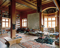 Reinhold Messner's restoration includes the large wood panelled living area which he has transformed into a study/library