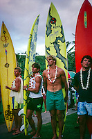 Gary 'Kong' Elkerton (AUS), Buzzy Kerbox (HAW)  and Laird Hamilton (HAW) at the opening ceremony of the Quiksilver Eddie  Aikau Big Wave Invitational at Wiamea Bay on Oahu's North Shore in the late 80's. circa 1988. Photo: joliphotos.com