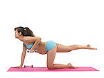 Pregnant young woman doing pilates workout isolated on white background