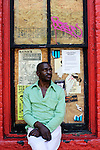 Mark Burgess, resting in a window near Euclid and moreland in Little Five Points. Originally from Belize, homeless and seeking work in Little Five Points. Suffering from a hernia and asthma.