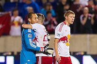 New York Red Bulls goalkeeper Luis Robles (31) celebrates with Brandon Barklage (25) after the match. The New York Red Bulls defeated Toronto FC 4-1 during a Major League Soccer (MLS) match at Red Bull Arena in Harrison, NJ, on September 29, 2012.