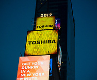 """The Toshiba sign illuminates from One Times Square in New York on Tuesday, April 11, 2017. Toshiba announced that there is  """"substantial uncertainty""""  whether the company can continue citing losses stemming from its Westinghouse Electric nuclear division.   (© Richard B. Levine)"""