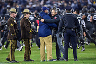 Baltimore, MD - DEC 10, 2016: Army Black Knights head coach Jeff Monken and Navy Midshipmen head coach Ken Niumatalolo meet in the middle of the field after Army defeated Navy 21-17 at M&T Bank Stadium, Baltimore, MD. (Photo by Phil Peters/Media Images International)