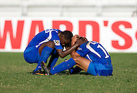Bryan Rochez (4) of Honduras comforts Oscar Roque (10) after the quarterfinals of the CONCACAF Men's Under 17 Championship at Catherine Hall Stadium in Montego Bay, Jamaica. Jamaica defeated Honduras, 2-1.