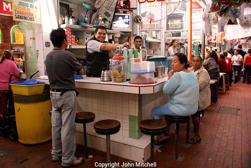 People at a juice and snack stand in the market in the city of Veracruz, Mexico