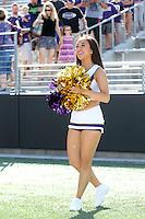 AUG 16, 2014:  University of Washington cheerleader Miki Saito during Football Picture Day at Husky Stadium in Seattle, Washington