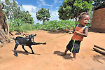 A boy pulls his reluctant goat along on a farm in Zombwe, in northern Malawi.