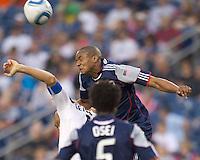 Los Angeles Galaxy defender Gregg Berhalter (16) and New England Revolution defender Darrius Barnes (25) battle for head ball. The New England Revolution defeated LA Galaxy, 2-0, at Gillette Stadium on July 10, 2010.