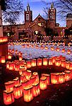 Christmas eve luminarias, Old Town Plaza, Albuquerque, New Mexico. San Felipe de Neri church in background.