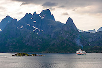 Norway, Lofoten. Raftsundet is a 20km long strait separating Austvågøya and Hinnøya. Hurtigruta on it's way to Trollfjorden.