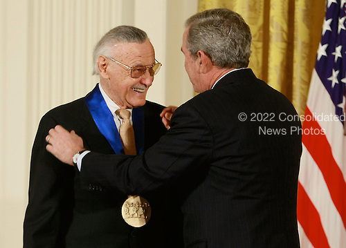 Washington, DC - November 17, 2008 -- United States President George W. Bush congratulates Stan Lee, founder of POW! Entertainment after presenting him with the 2008 National Medals of Arts award during an event in the East Room at the White House on Monday, November 17, 2008 in Washington, DC. During the event president Bush presented recipients with awards for the National Medals of Arts and the National Humanities Medal.  (Photo by Mark Wilson/Getty Images)Credit: Mark Wilson - Pool via CNP