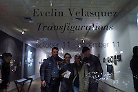 """Stamford, CT. 11 October 2014. Colombian Artist Evelin Velasquez (2 R) attends the Opening of her solo Exhibit """"Transfigurations"""" at the Fernando Luis Alvarez Gallery in Stamford . Photo by Eduardo Munoz/VIEWpress"""