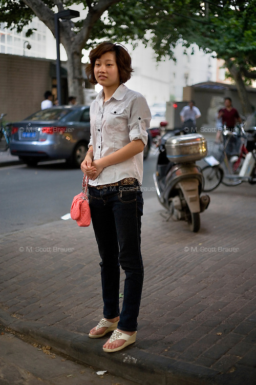 Wangaiai, an independent clothing capitalist, age 21, poses for a portrait in Nanjing. Response to 'What does China mean to you?': 'No way to express.'  Response to 'What is your role in China's future?': 'I feel very confident about the future.'