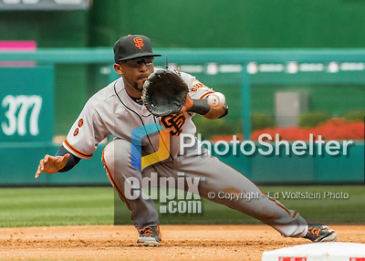 7 August 2016: San Francisco Giants third baseman Eduardo Nunez nabs a sharp line drive by Washington Nationals Trea Turner for the 3rd out of the 3rd inning at Nationals Park in Washington, DC. The Nationals shut out the Giants 1-0 to take the rubber match of their 3-game series. Mandatory Credit: Ed Wolfstein Photo *** RAW (NEF) Image File Available ***