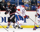 Anthony Bitetto (Northeastern - 7), Shayne Thompson (Lowell - 23) - The visiting Northeastern University Huskies defeated the University of Massachusetts-Lowell River Hawks 3-2 with 14 seconds remaining in overtime on Friday, February 11, 2011, at Tsongas Arena in Lowelll, Massachusetts.