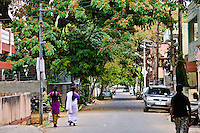 Women walk home on Bangalore India's green streets.
