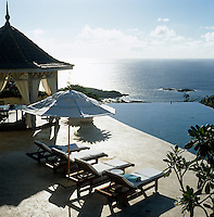 The infinity pool and coral stone terrace reflect the changes of light as the sun moves through the day