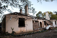 One of Durban Deep gold mine's historic homes is photographed a day after it was stripped of all its valuable materials on the outskirts of Johannesburg, South Africa. While homes like this one housed gold mining managers when Durban Deep was still in operation, they have since been home to many local families, some of whom are the children or grandchildren of the goldminers and have no where else to go.
