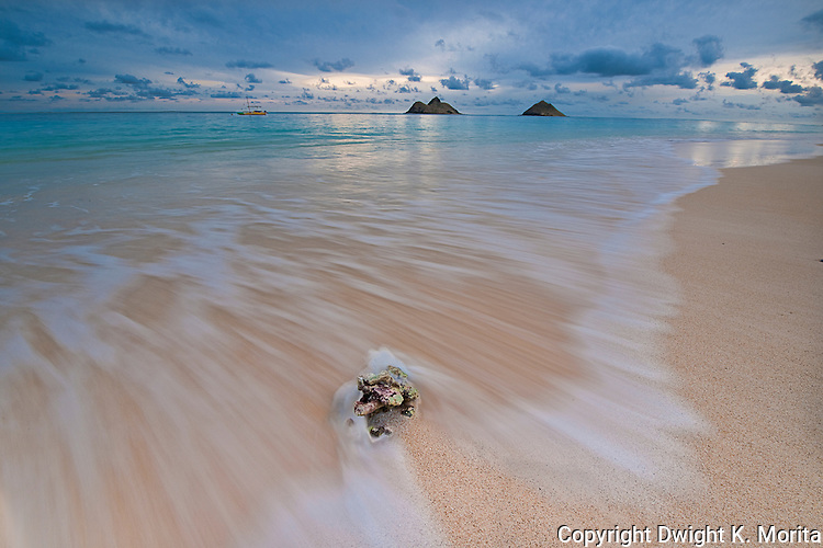 Incoming tide at dawn on Lanikai Beach with the Mokulua Islands in the background.