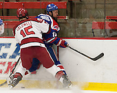 John Caldwell (Harvard - 15), Josh Holmstrom (UML - 12) - The visiting University of Massachusetts Lowell River Hawks defeated the Harvard University Crimson 5-0 on Monday, December 10, 2012, at Bright Hockey Center in Cambridge, Massachusetts.