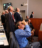 In Firing Room 4 of the Launch Control Center, NASA Administrator, Dr. Michael Griffin (foreground) and other mission mangers watch the launch of Space Shuttle Discovery on mission STS-121.&nbsp; Liftoff was on-time at 2:38 p.m. EDT.&nbsp; During the 12-day mission, the STS-121 crew of seven will test new equipment and procedures to improve shuttle safety, as well as deliver supplies and make repairs to the International Space Station. Landing is scheduled for July 17 at Kennedy's Shuttle Landing Facility. Photo Credit: &quot;NASA/Bill Ingalls&quot;
