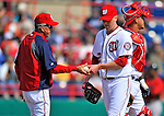 4 March 2012: Washington Nationals pitcher Tom Gorzelanny hands the ball over to Manager Davey Johnson during a game against the Houston Astros at Space Coast Stadium in Viera, Florida. The Astros defeated the Nationals 10-2 in Grapefruit League action. Mandatory Credit: Ed Wolfstein Photo