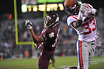 Mississippi State wide receiver Arceto Clark (19) is defended by Ole Miss' Cliff Coleman (33) in Starkville, Miss. on Saturday, November 26, 2011. Mississippi State won 31-3.