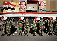Army colleagues carry the coffins of their colleagues from the Syrian Army who have died in fighting around Damascus at their funeral. On the wall behind them images of Hafez al Assad and his son Bashar al Assad are visible.Protests against the ruling Baathist regime of Bashar al-Assad erupted in March 2011. Although they were initially peaceful,  they were violently repressed by the Syrian army and police. In response to being ordered to shoot unarmed civilians, large numbers of men deserted the army and formed the Free Syrian Army. The protest movement has now turned into an armed uprising with clashes between the regular army and the Free Syrian Army taking place in early 2012..