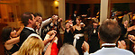 Reception guests come together in dance as they celebrate the newly married couple.