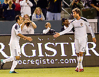 LA Galaxy midfielder's Landon Donovan (l) and David Beckham (r) congratuate one another after a Donovan goal. The LA Galaxy defeated DC United 2-1at Home Depot Center stadium in Carson, California on Saturday September 18, 2010.
