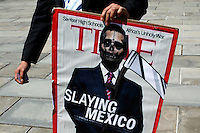 A man carries a illustration of Mexico's president Enrrique Pena Nieto while parents of the missing 43 students of Ayotzinapa, hold a press conference at the steps of the New York City Hall in New York.  04/22/2015. Eduardo MunozAlvarez/VIEWpress