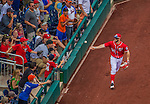28 July 2013: Washington Nationals outfielder Bryce Harper tosses the ball the a fan after pulling in a foul ball for the third out during a game against the New York Mets at Nationals Park in Washington, DC. The Nationals defeated the Mets 14-1. Mandatory Credit: Ed Wolfstein Photo *** RAW (NEF) Image File Available ***