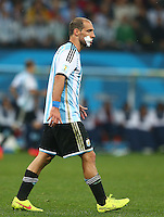 Pablo Zabaleta of Argentina with a padded dressing to a wound to his mouth
