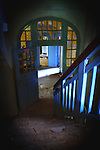 Some stairs in an old mantal hospital