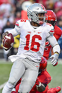 College Park, MD - NOV 12, 2016: Ohio State Buckeyes quarterback J.T. Barrett (16) breaks a tackle and scores a touchdown during game between Maryland and Ohio State at Capital One Field at Maryland Stadium in College Park, MD. (Photo by Phil Peters/Media Images International)