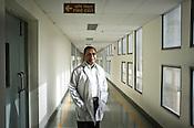 41 year old neurosurgeon, Dr. Deepak Agarwal poses for a portrait in the corridor of the Jai Prakash Narayan Apex Trauma Centre, AIIMS in New Delhi, India. Photo: Sanjit Das/Panos